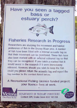 Photo of a public information sign providing information about tagged fish