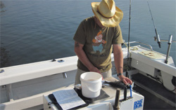An angler diarist measuring his catch.