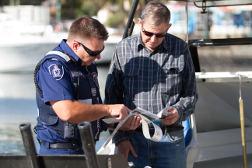 ranger checking a licence